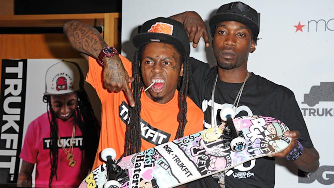 Grammy Award Winning Hip Hop Icon Lil Wayne and Professional Skateboarder Stevie Williams celebrate the launch of their contemporary clothing lines TRUKFIT and DGK at Macy's stores on Friday June 1, 2012 in Los Angeles. (Photo by Katy Winn/Invision)