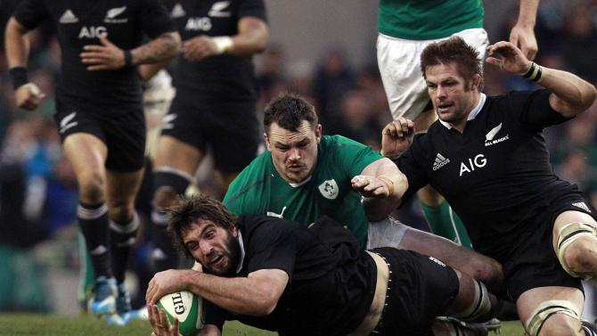 New Zealand's Whitelock is challenged by Ireland's Healy in International rugby union match in Dublin