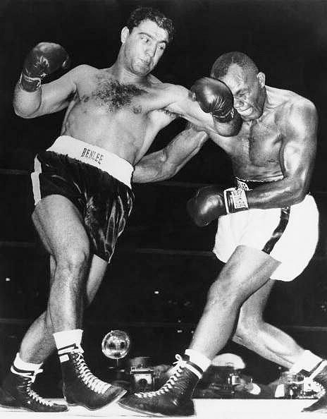 6. Rocky Marciano TKO13 Jersey Joe Walcott, Sept. 23, 1952 – This fight marked the start of Marciano's reign as heavyweight champion. He was far behind on points, but caught Walcott on the chin with a right cross that led to one of the great boxing photos of all-time. The photo showed the punch at the moment of impact, with Walcott's face grotesquely contorted. (Photo credit: Getty)