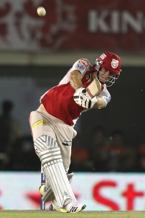David Miller of Kings XI Punjab hits over the top for six during match 51 of the Pepsi Indian Premier League (IPL) 2013 between Kings XI Punjab and the Royal Challengers Bangalore held at the PCA Inte