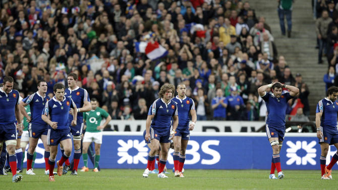 France's rugby team players after missing a try during the Six Nations Rugby Union tournament at the stade de France stadium, in Saint Denis, outside Paris, Saturday, March 15, 2014. (AP Photo/Christophe Ena)