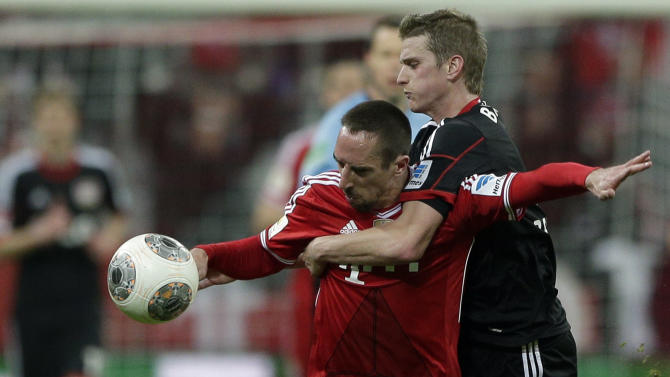 Bayern's Franck Ribery, left, and Leverkusen's Lars Bender challenge for the ball during the German first division Bundesliga soccer match between FC Bayern Munich and Bayer 04 Leverkusen, in Munich, southern Germany, Saturday, March 15, 2014