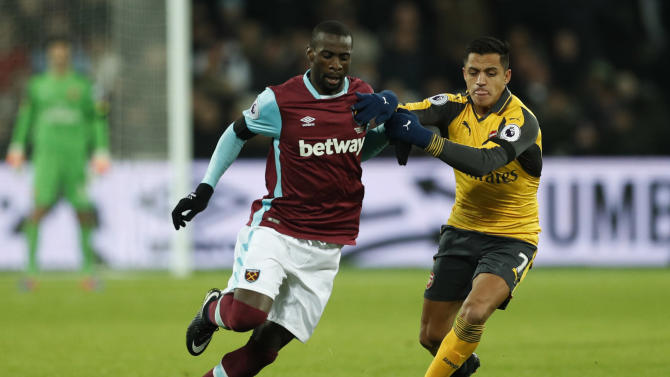 West Ham United's Pedro Obiang in action with Arsenal's Alexis Sanchez