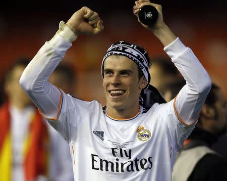 Real Madrid's Gareth Bale celebrates after defeating Barcelona in their King's Cup final soccer match at Mestalla stadium in Valencia
