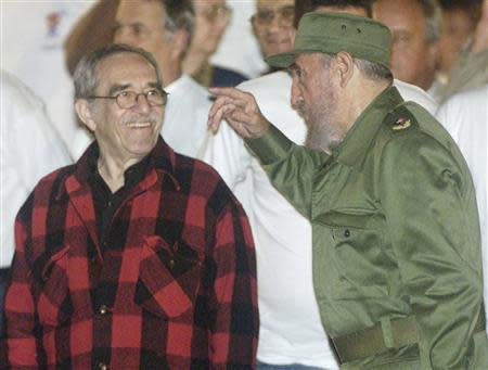 Cuban then President Castro and Colombian Nobel Prize laureate Garcia Marquez attend the inauguration of the first Cuban national Olympic games in Havana's Revolution Square