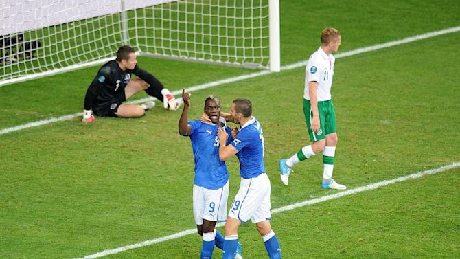Mario Balotelli (second left) celebrates Italy's second goal