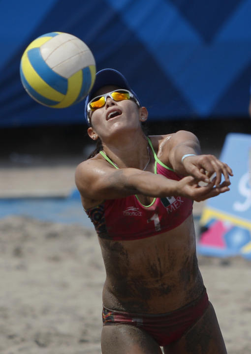 Mexico's Mayra Garcia hits the ball during the women's beach volleyball final match against Brazil at the Pan American Games in Puerto Vallarta, Mexico, Friday, Oct. 21, 2011. (AP Photo/Ariana Cubillo