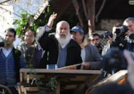 A Turkish man speaks to a crowd about doomsday in Sirince, a village in western Turkey, on December 21, 2012. As the village of Sirince waited for what some say is an apocalypse from which the tiny Turkish hamlet will be spared, its streets were teeming not with doomsayers but a hoard of disappointed journalists