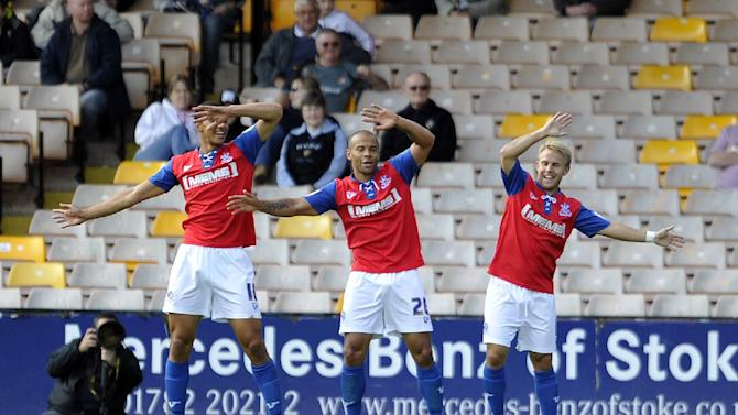 Deon Burton, centre, leads the celebrations after his goal helped Gillingham remain top