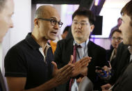 Microsoft CEO Satya Nadella gestures while speaking with reporters after giving a press briefing on the intersection of cloud and mobile computing Thursday, March 27, 2014, in San Francisco. Microsoft unveiled Office for the iPad, a software suite that includes programs such as Word, Excel and PowerPoint, and works on rival Apple Inc.'s hugely popular tablet computer. (AP Photo/Eric Risberg)