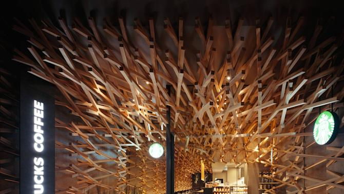 Kengo Kuma designs the world's most peaceful StarbucksIf all Starbucks cafes looked like this, it would almost certainly put an end to take-out drinks! After all, who would want to leave a building this tranquil?Architects at Tokyo-based and world-renowned Kengo Kuma & Associates firm have designed a Starbucks store in Japan that draws on its peaceful surroundings. Located in the Fukuoka Perfecture, it can be found on a street leading directly to the Dazaifu Tenmagu holy shrine, which is dedicated to a Japanese deity. Fukuoka, Japan - 21.03.12Mandatory Credit: Masao Nishikawa/WENN.ComSupplied by WENN.com