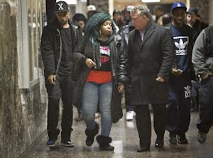 Leslie Pollard, second from left, leaves a court hearing…