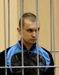 Dmitry Konovalov, one of the two men sentenced to death for a deadly Minsk metro bombing last year, standing inside the defendant cage during his trial in the House of Justice in the Belarus capital Minsk in 2011. Belarus has executed both men convicted of a Minsk metro bombing that killed 15 people in the nation's worst attack since its post-Soviet independence, state television reported