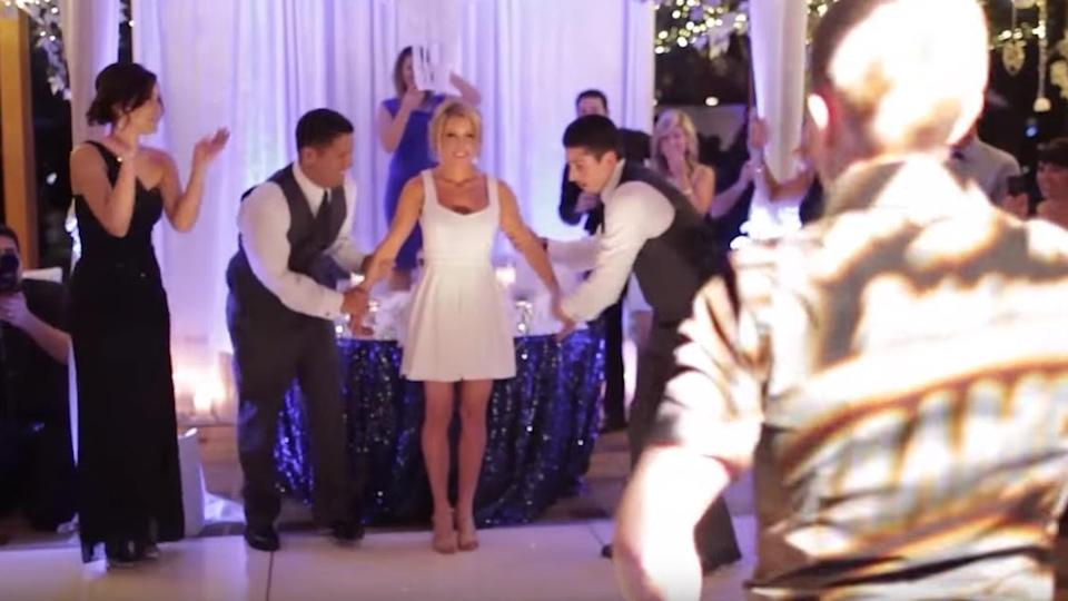 Couple's Beautifully Choreographed Wedding Dance To A Classic Hit Has The Crowd Cheering!