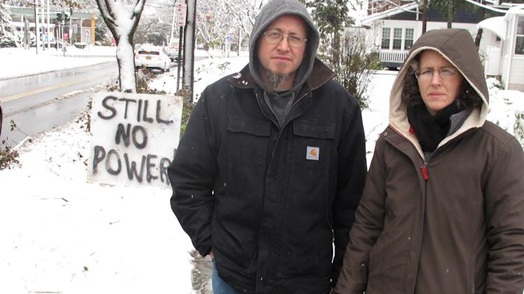 Vincent and Jeanmarie Pina placed a sign outside their home saying they still have no electric power on Thursday, Nov. 8, 2012 in Farmingdale, N.Y. The couple said they have remained in their home for 11 days waiting for their lights to come back on. (AP Photo/Frank Eltman)