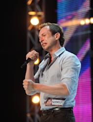 Don Philip performs in front of the judges on part-one of the two night season premiere of 'The X Factor,' Sept. 12, 2012 -- FOX