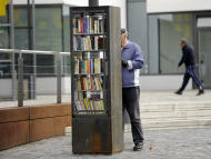 In this picture taken Monday Oct. 10, 2011 a public book shelf stands on a square in Cologne, Germany. Take a book, leave a book. In the birthplace of the printing press, public bookshelves are popping up across the nation on street corners, city squares and suburban supermarkets. In these free-for-all libraries, people can grab whatever they want to read, and leave behind anything they want for others. There's no need to register, no due date, and you can take or give as many as you want.(AP Photo/Martin Meissner)