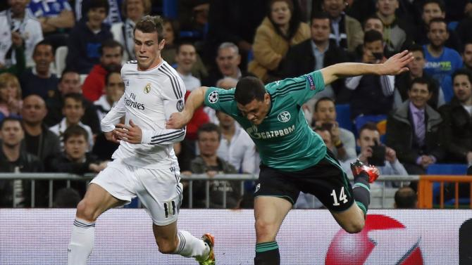Real Madrid's Bale is tackled by Schalke 04's Papadopoulos during their Champions League last 16 second leg soccer match in Madrid
