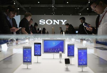 People look at devices at the Sony stand during the Mobile World Congress in Barcelona