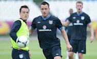 English defender John Terry (C) and English midfielder Scott Parker (L) take part in a training session in Krakow. Parker insists his recent clash with Mario Balotelli is ancient history as he prepares to battle the Italy striker in Sunday's European Championship quarter-final