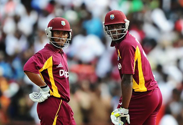 West Indies cricketers Carlton Baugh (L)