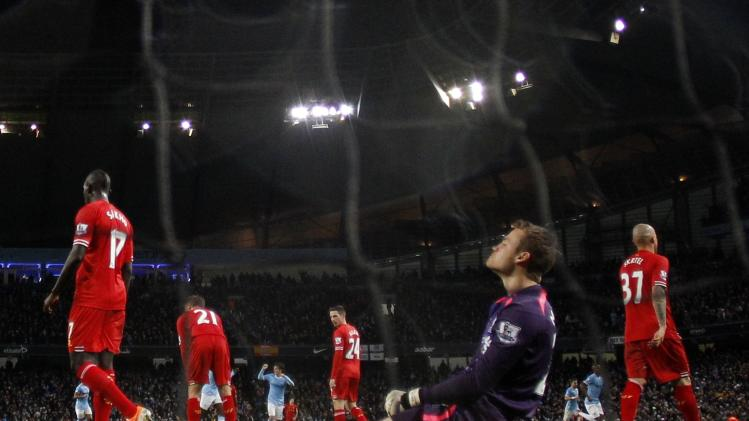 Liverpool's goalkeeper Mignolet reacts after Manchester City's Negredo scores a goal during their English Premier League soccer match at the Etihad stadium in Manchester