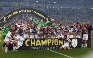 Germany's players pose for pictures as they celebrate with their World Cup trophy after winning their 2014 World Cup final against Argentina at the Maracana stadium in Rio de Janeiro