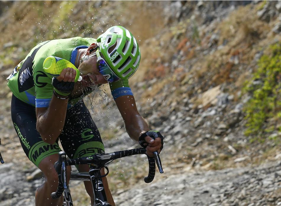 Cannondale-Garmin rider Koren of Slovenia drinks as he climbs during the 14th stage of the Tour de France cycling race