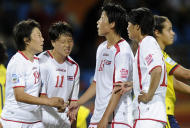 North Korean players react following the group C match between North Korea and Colombia at the Women's Soccer World Cup in Bochum, Germany, Wednesday, July 6, 2011. (AP Photo/Martin Meissner)