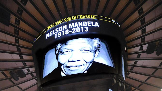 A moment of silence in honor of former South African President Nelson Mandela, who died Thursday, is observed before the New York Knicks and the  Orlando Magic play an NBA basketball game Friday, Dec. 6, 2013, at Madison Square Garden in New York
