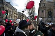File picture shows couples kissing on Valentine's Day in Paris. Where are people most unfaithful? Who uses sex toys? On a darker level, where is child rape more prevalent? French geographers have tried to answer these questions and others in a global atlas on sexuality