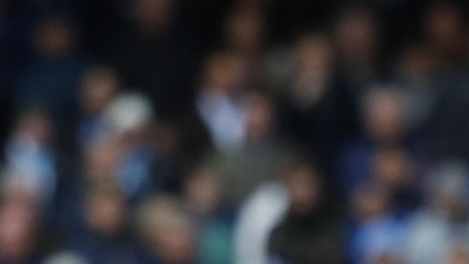 Manchester City's Nicolas Otamendi reacts after being shown a yellow card