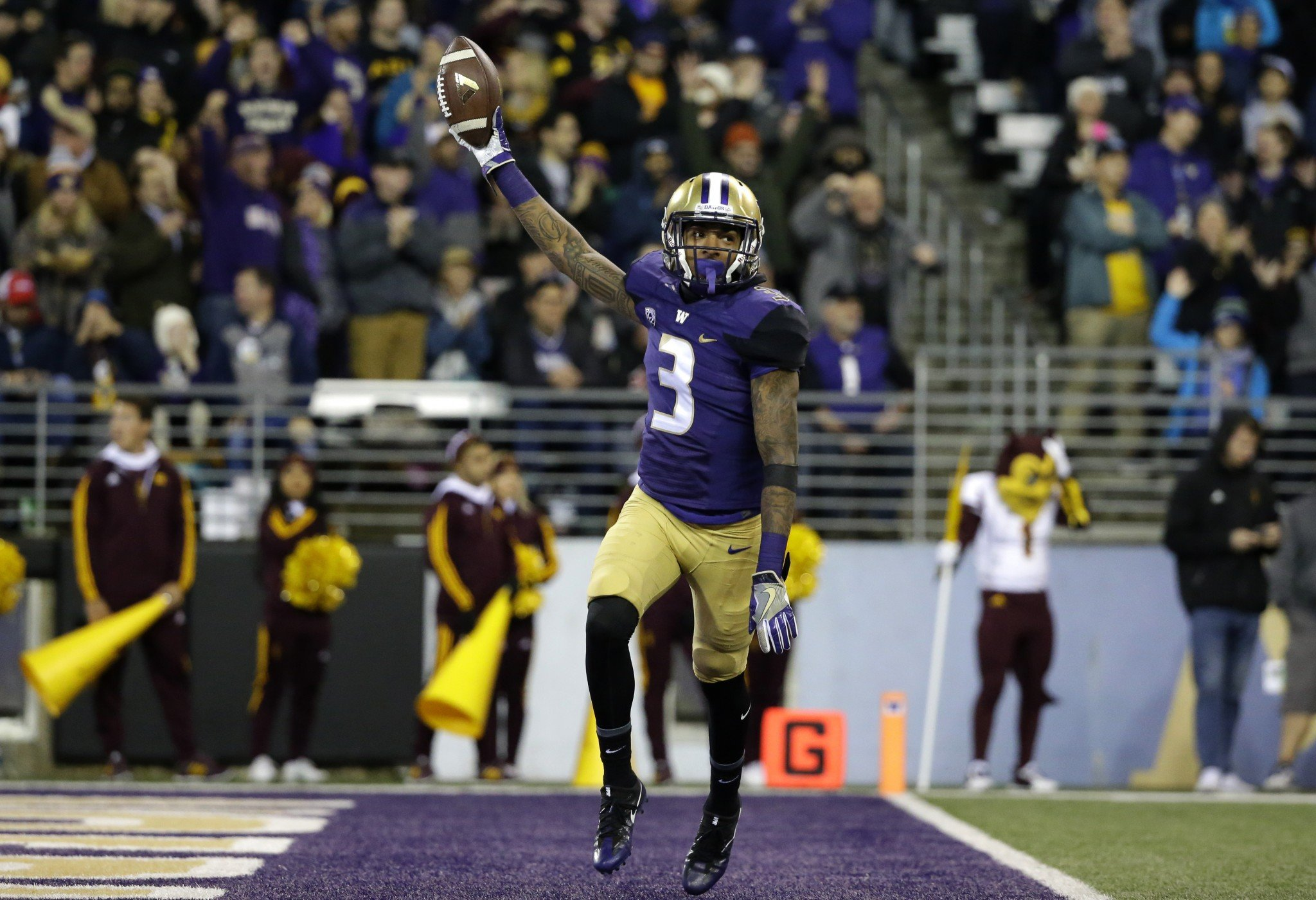 Washington defensive back Darren Gardenhire celebrates after recovering a fumble Saturday against Arizona State. (AP Photo/Ted S. Warren)