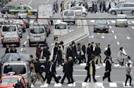 Pedestians cross a street in downtown Tokyo. Japan's central bank on Friday held off fresh easing measures, with analysts saying that policymakers were waiting to see how the weekend's Greek election would affect the eurozone crisis