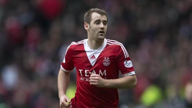 Football - McGinn snatches win for Dons