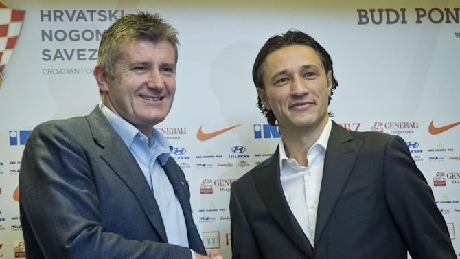 Newly appointed head coach of Croatia's national soccer team Niko Kovac, right, shakes hands with Davor Suker, head of the Croatian Soccer Federation, after a news conference in Zagreb, Croatia, Thursday, Oct. 17, 2013. Kovac succeeded Igor Stimac who was fired after a defeat from Scotland in a world Cup qualifier