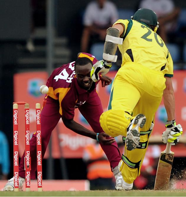 West Indies cricketer Kemar Roach (L) at