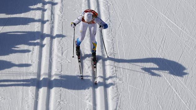 2014Sweden's Lars Nelson continues after falling during the first lap in the men's cross-country 4 x 10km relay event at the 2014 Sochi Winter Olympics February 16, 2014