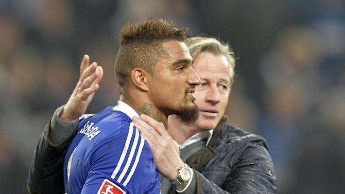 Schalke's Kevin-Prince Boateng, left, is embraced by Schalke head coach Jens Keller after the German  Bundesliga soccer  match between FC Schalke 04 and Werder Bremen in Gelsenkirchen, Germany, Saturday, Nov. 9, 2013