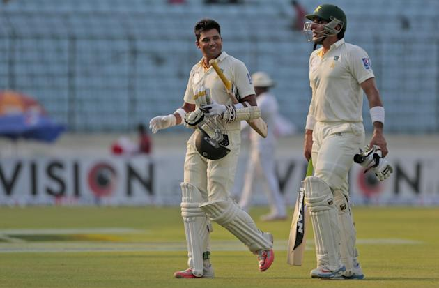 Pakistan's Azhar Ali, left, and captain Misbah-ul-Haq walk back from the field at the end of the first day of their second test cricket match against Bangladesh in Dhaka, Bangladesh, Wednesday, May 6,