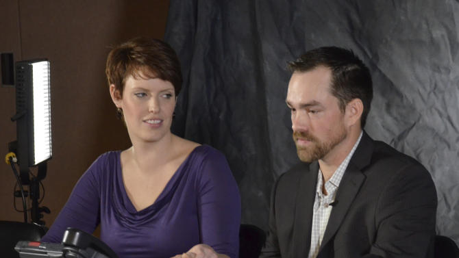 In this Jan. 16, 2013 file photo Clint Romesha, a North Dakota veteran set to receive the Medal of Honor for courageous action during a 13-hour firefight in Afghanistan, right, speaks at a news conference alongside his wife, Tammy, Wednesday in Minot, N.D. Romesha, 31, will receive the nation's highest military decoration for valor at the White House on Feb. 11. (AP Photo/The Minot Daily News, Eloise Ogden)