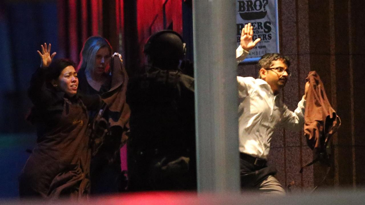 Hostage situation erupts in Sydney cafe