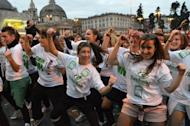 People dance on the 'Gangnam style' song during a flashmob organized at Piazza del Popolo on November 10, 2012 in Rome