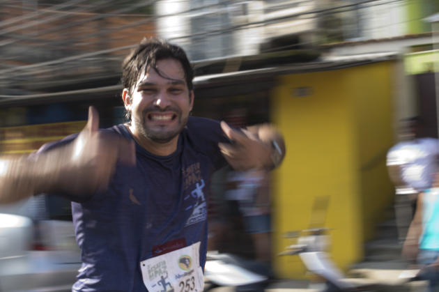 "People take part in the ""Race for Peace"" along the Alemao shantytown to celebrate the second anniversary of its pacification by police, in Rio de Janeiro, Brazil, on May 27, 2012. One thousand amateur runners from the shantytown and one thousand more from other slums, as many artists and public figures took part in the event, whose path was set following the escape route taken by the drug traffickers when they were chased out of the area. AFP PHOTO / Christophe SimonCHRISTOPHE SIMON/AFP/GettyImages"