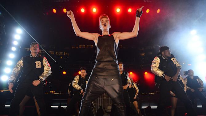 Justin Bieber performs during the half-time show at the CFL Grey Cup championship football game between the Toronto Argonauts and the Calgary Stampeders Sunday Nov. 25, 2012 in Toronto. (AP Photo/The Canadian Press, Sean Kilpatrick)