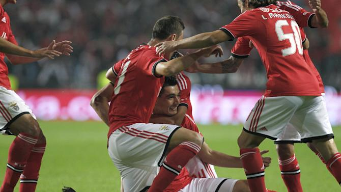 Benfica's Oscar Cardozo, center, from Paraguay, celebrates with teammates after scoring the opening goal against Sporting during a Portugal Cup soccer match between Benfica and Sporting at Benfica's Luz stadium in Lisbon, Saturday, Nov. 9, 2013. Cardozo scored a hat-trick in Benfica's 4-3 victory