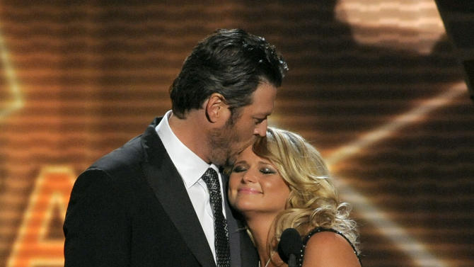 "Miranda Lambert, right, and Blake Shelton accept the award for song of the year for ""Over You"" at the 48th Annual Academy of Country Music Awards at the MGM Grand Garden Arena in Las Vegas on Sunday, April 7, 2013. (Photo by Chris Pizzello/Invision/AP)"
