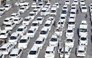 Cabs are parked in downtown Turin as taxi drivers stopped all over Italy to protest against a government proposed bill on transportation that they fear would endanger their business by favoring American worldwide online transportation network company Uber, Thursday, Feb. 16, 2017. (Alessandro Di Marco/ANSA via AP)