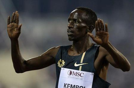 Ezekiel Kemboi of Kenya celebrates his victory in the men's  3000m Steeplechase during the IAAF Diamond League athletics meet in Doha