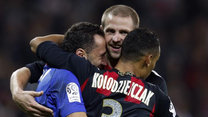 Nice's goalkeeper David Ospina, Mathieu Bodmer and Thimothee Kolodziejczak react at the end of their French Ligue 1 soccer match against Olympique Marseille at Allianz Riviera stadium in Nice